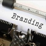 The word 'branding' typed out on a typewriter.